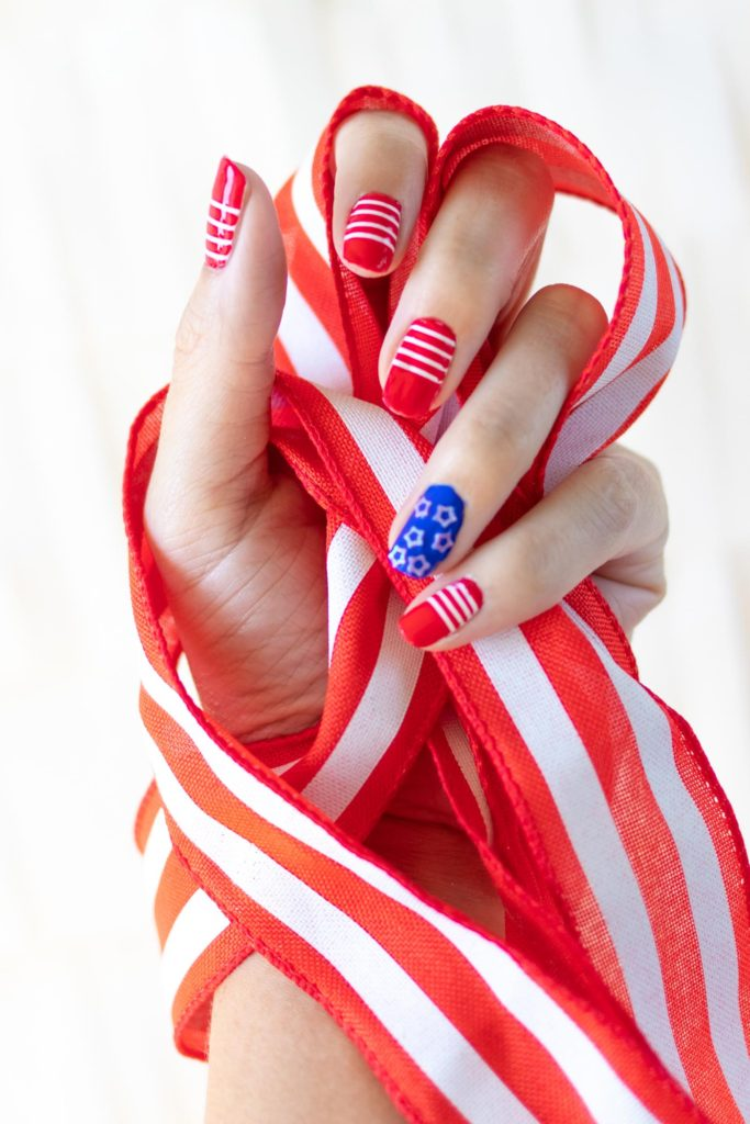 Try these simple 4th of July nails! Give yourself a DIY manicure for Independence Day with your favorite nail polishes! // #4thofjuly #nailideas #manicure #nailpolish #diybeauty