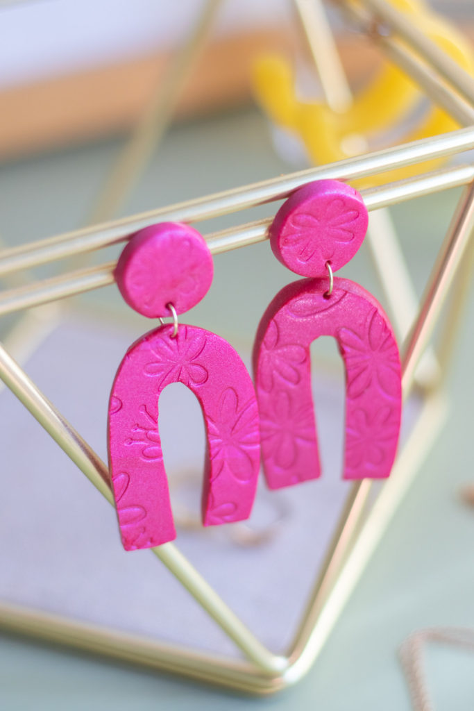 DIY Embossed Earrings with Clay // Make DIY statement earrings with this easy embossing technique for clay using paper embossing sheets! Use your favorite colors and shapes to make unique, lightweight DIY jewelry! #diyjewelry #statementearrings #fashiondiy #accessories #womensfashion #polymerclay #embossed #earrings #jewelry