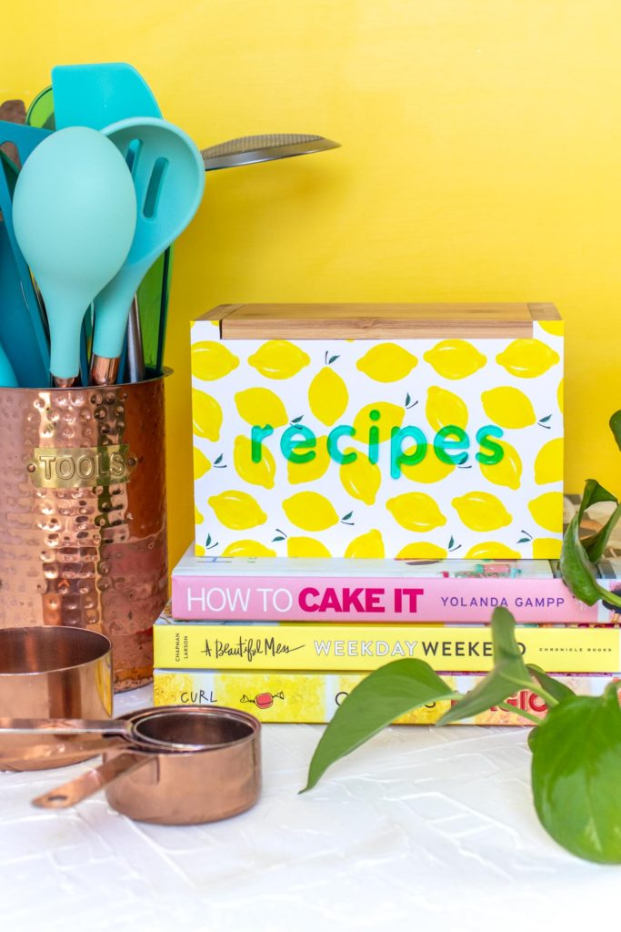 DIY Recipe Box Makeover with Wallpaper // Use removable wallpaper to makeover a simple wood recipe box! Add printable recipe cards and cute dividers to organize recipes in style! #diyideas #homedecor #recipecards #papercrafts #wallpaper #easydiy #giftideas #diygifts #diystorage #storageideas