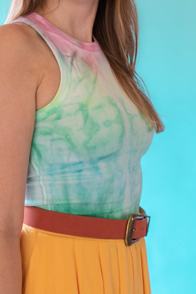 How to Tie Dye with Fabric Paint // See how to create tie dye with soft fabric paint by Tulip! #ad Make tie dye patterns on any fabric with just paint and water. Click through for the full video! #tiedye #dyeing #fabric #painting #fabricpaint #summerdiy #fashiondiy #tshirt