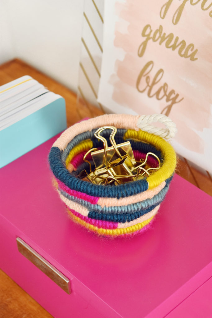 DIY Mini Yarn Wrapped Rope Bowl // Make a mini bowl to organize small items like clips and pins around the house with this cute DIY bowl by Faith of @designfixation! Wrap rope with your favorite colors of yarn to make a rope bowl that fits in anywhere! #bowl #storagediy #organization #ropebowl #yarncrafts #fiberart #fibercrafts #homeoffice #officediy #homedecor #diydecor