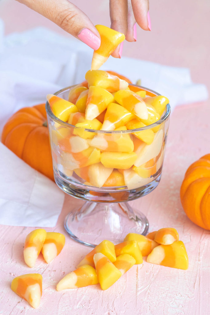 Easy Candy Corn Fudge // Make white chocolate fudge with honey that looks just like pieces of candy corn! This 3-ingredient fudge is the perfect Halloween treat for kids and adults! #candycorn #candy #fudgerecipes #whitechocolate #halloweensnacks #fallsnacks #fall #halloween #halloweentreats