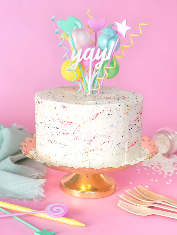 Colorful Splatter Cake // Decorate your favorite cake with splattered food coloring for a fun take on splatter paint designs popular in the 1980s and 90s, perfect for birthdays and other celebrations! #cakedecorating #cake #cakeideas #birthdaycake #birthday #painting #90s #80s