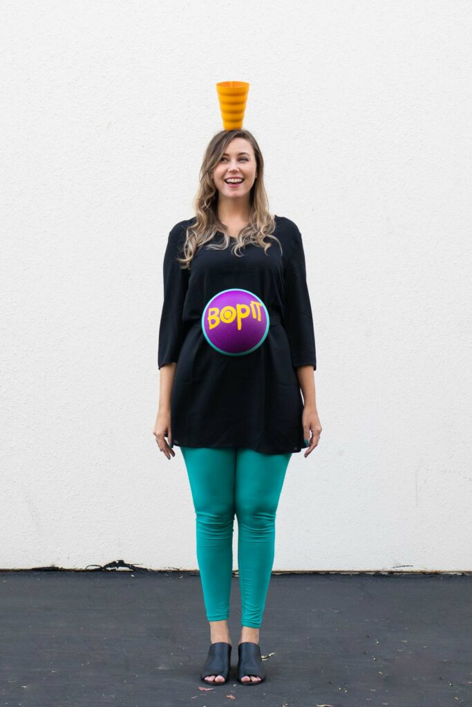 DIY Bop It! Costume // Recreate the classic 90s toy Bop It! with a few simple supplies! This easy 90s toy costume is the perfect nostalgic costume for adults! #costume #halloween #90s #toycostume #adultcostume #halloweencostume #diycostume