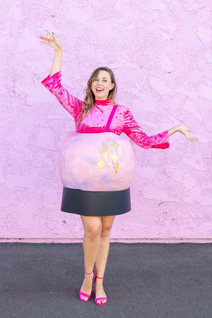 DIY Crystal Ball Costume for Halloween // Use paper mache on a large balloon to create a DIY halloween costume that looks like a mystical crystal ball used by a fortune teller! #crystalball #papermache #halloween #costume #kidscostume #adultcostume
