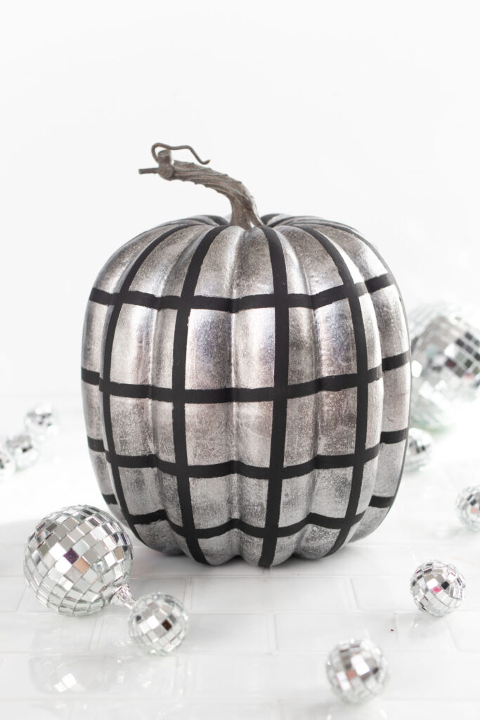 DIY Disco Ball Pumpkin Painting Idea! See how to paint pumpkins to look like sparkly disco balls for decorate for fall and Halloween! #halloween #falldecor #pumpkins #painting #discoball #diyhalloween #falldiy