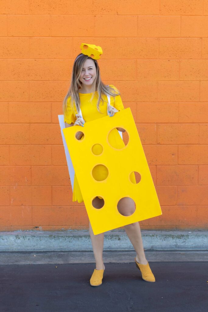 DIY Easy Cheese Costume (Cheeseboard Costume) // Use poster board to make a fun cheesy costume complete with a wedge of cheese headband! This easy last-minute costume is perfect for kids or adults to wear this Halloween #costume #easycostume #diycostume #halloween #adultcostumes #kidscostumes #cheese #posterboard