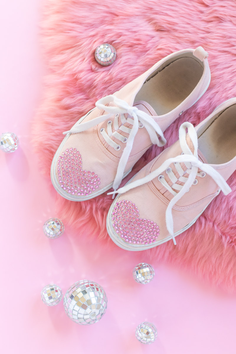 DIY Crystal Valentine's Day Shoes // Makeover old sneakers with colored crystals or rhinestones using Aleene's The Ultimate glue! This easy shoe update is perfect for Valentine's Day or any day of the year! #ad #shoemakeover #upcycle #stylediy #diystyle #shoediy #easydiy #diysforteens #craftsforteens #valentinesday #valentinesdaydiy #vdaydiy