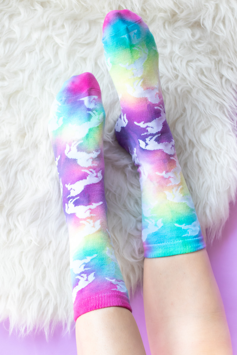 DIY Tie Dye Grip Socks // These easy DIY tie dye socks are the perfect craft for teens and young adults! Use a Tulip kit to make these colorful socks with painted neon grip for no-slip socks everyone needs #ad #tiedye #dyeing #nosew #painting #fabricpaint #kidscrafts #diysforteens #craftsforteens #teencrafts #slumberparty