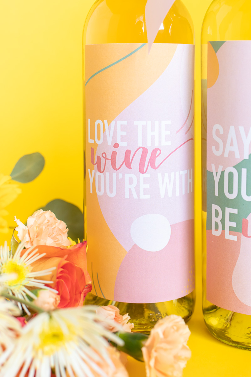 Printable Wine Labels // Easy Galentine's Day Gifts // Download this free printable artwork with wine puns for cute DIY wine labels! Add them to any wine bottle for a sweet semi-homemade gift for Galentine's Day gift for wine lovers! #valentinesday #winelover #stickers diylabels #freeprintable #abstractprint #galentinesday #diygifts #giftideas #giftsforwomen