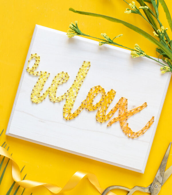 """relax"" graphic string art on yellow background"