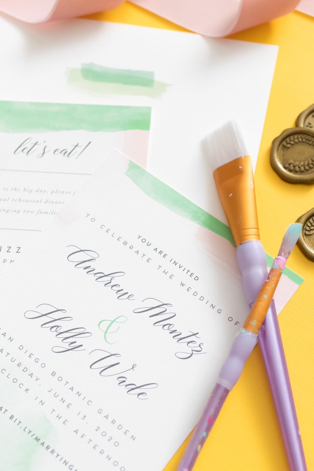 closeup of watercolor wedding invitations