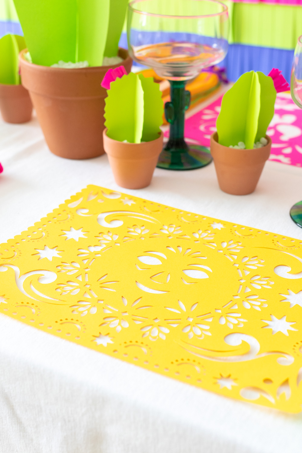 papel picado placemat design on white tablecloth with paper cacti