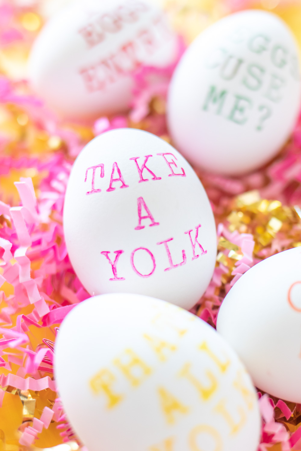 "punny easter egg that says ""take a yolk"""
