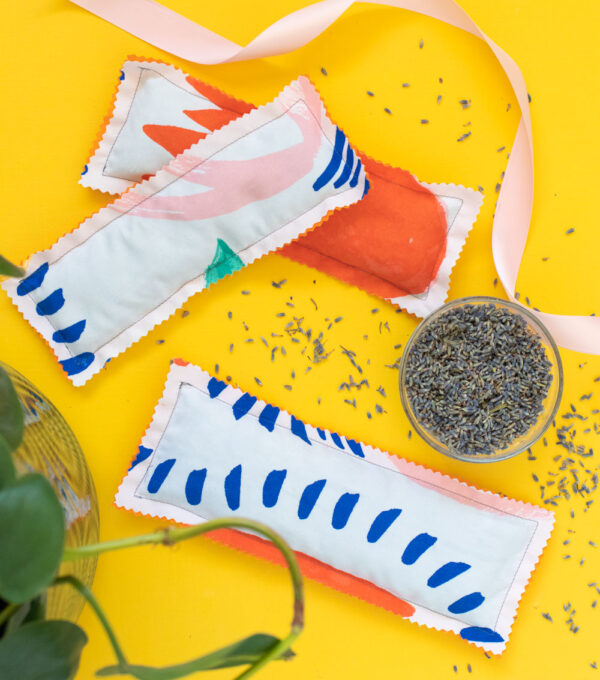 three lavender eye masks on yellow background