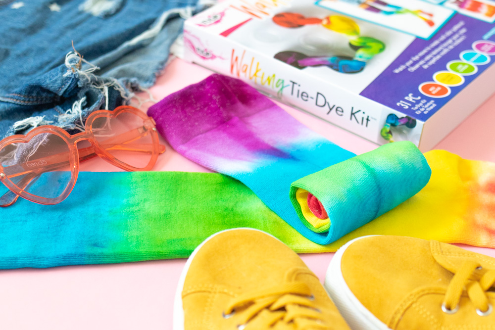 rolled up tie dye socks surrounded by accessories