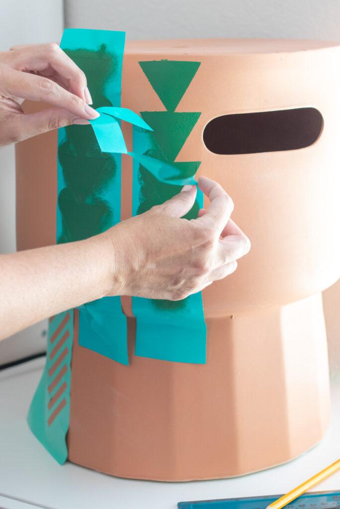 removing vinyl stencil on terracotta stool