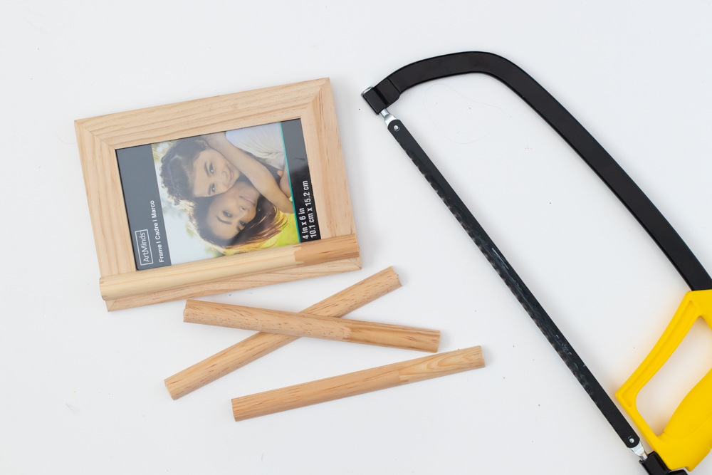 saw and pieces of trim for decorating picture frame