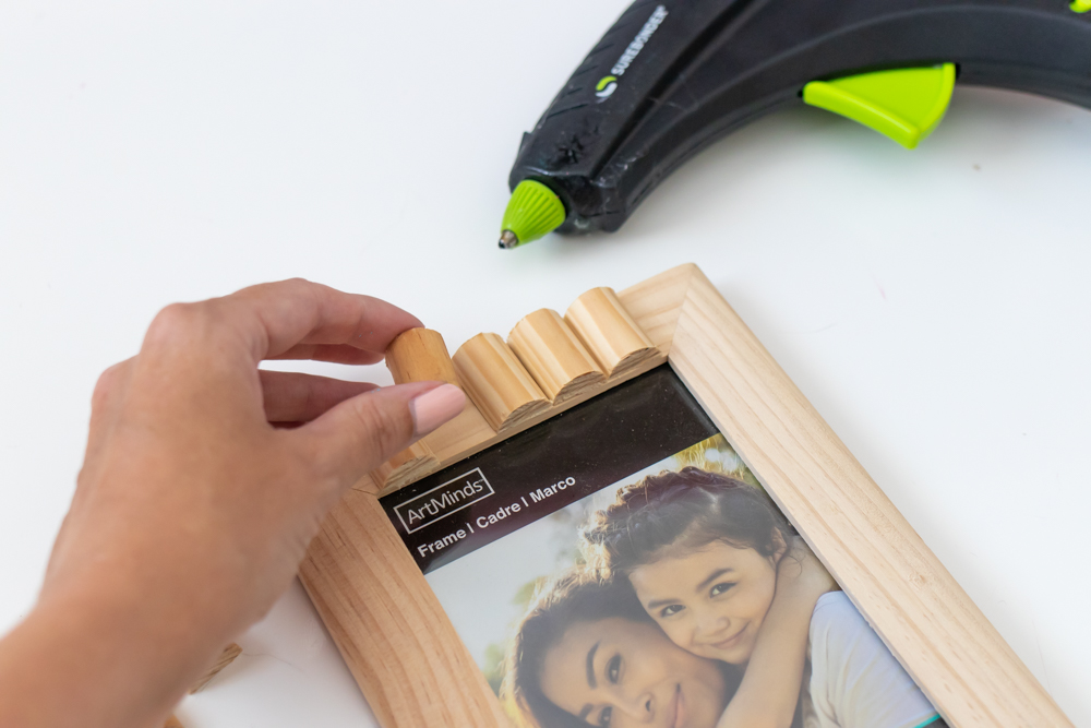 gluing wood trim pieces to picture frame