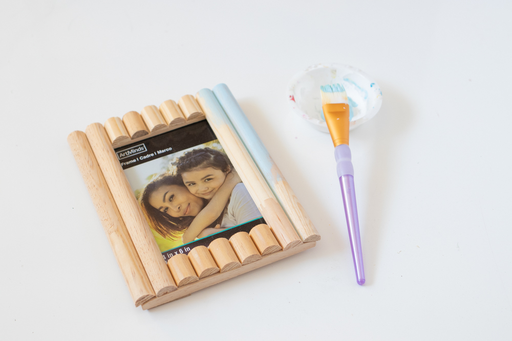 process of painting a photo frame decorated with trim