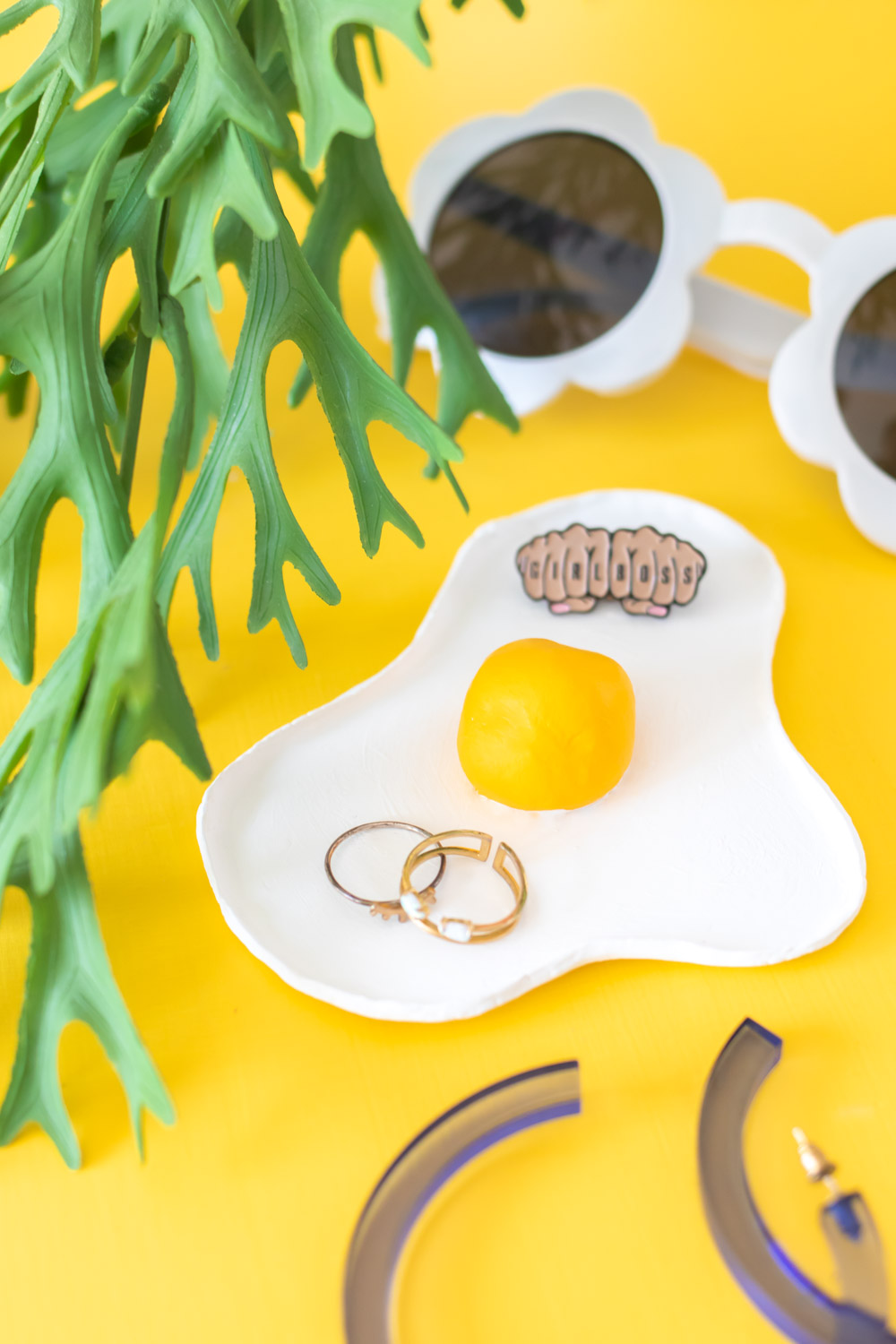 catch-all tray shaped like fried egg with rings and sunglasses