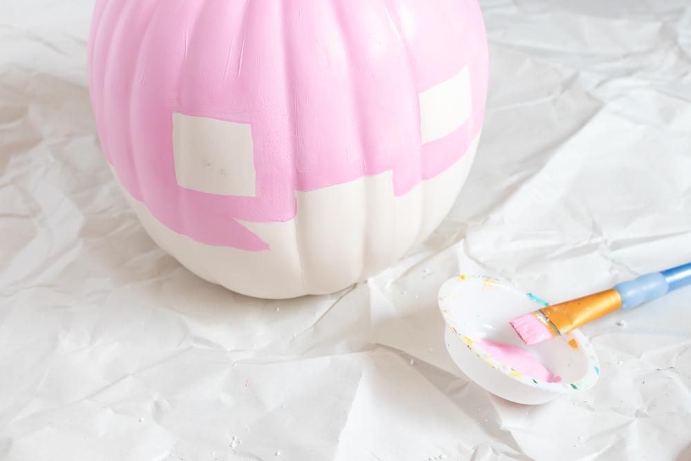 painting top half of vintage trailer pumpkin pink