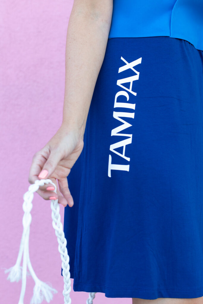 holding Tampax LeakGuard Braid for tampon costume