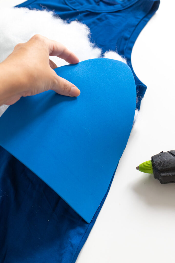 gluing foam applicator petals to a dress for tampon costume