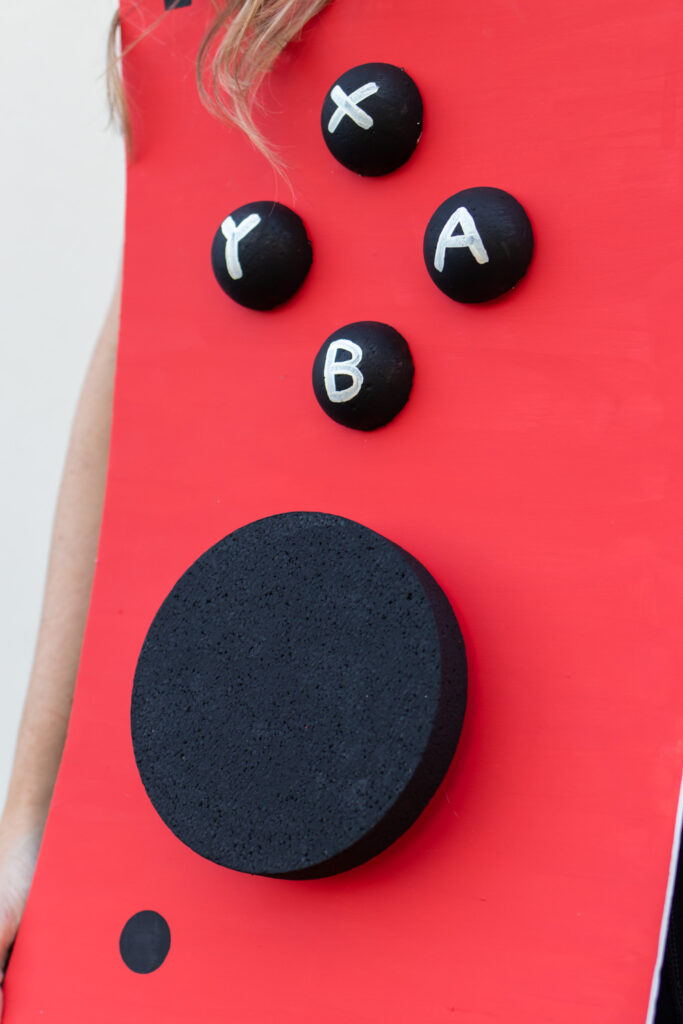 closeup of red Nintendo Switch costume controller