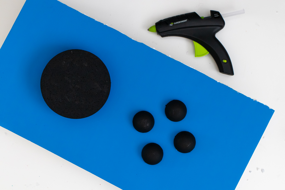 gluing buttons to video game costume base