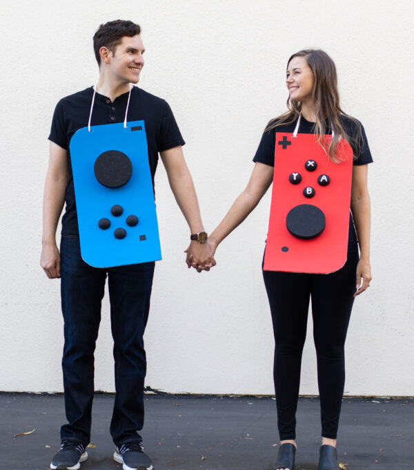 couple wearing Nintendo Switch costume against white background