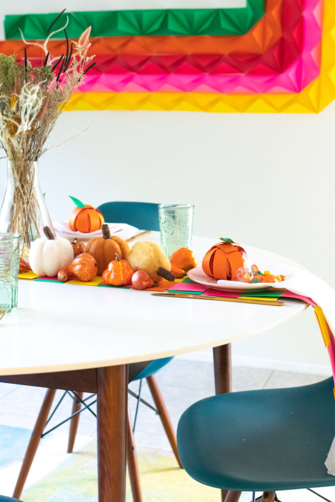 side view of colorful paper thanksgiving decor with pumpkins