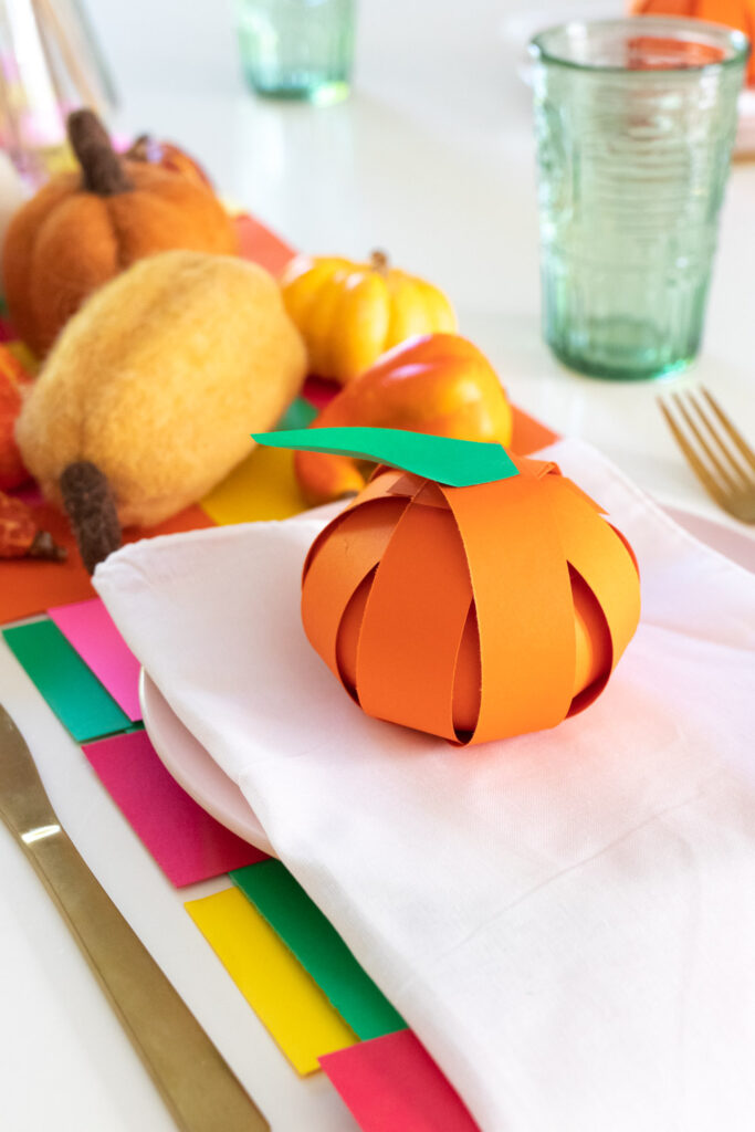 paper pumpkin treat placecard on plate