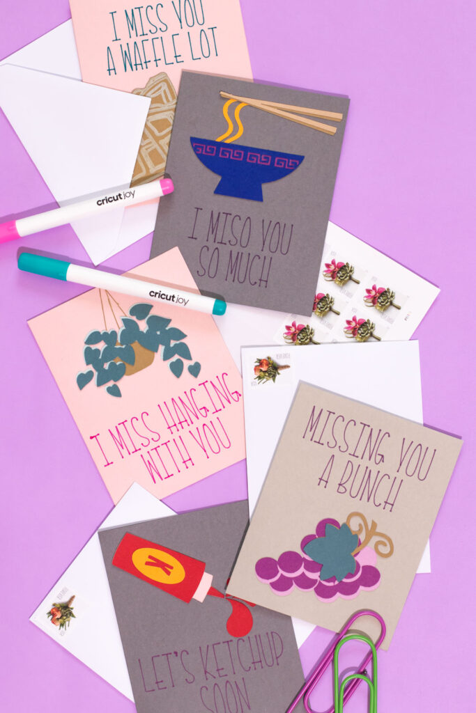 "flatlay collection of ""I miss you"" cards with Cricut Joy"