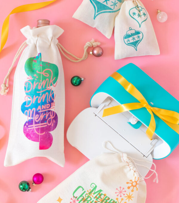 assortment of DIY holiday gift packaging ideas made with Cricut and vibrant colors