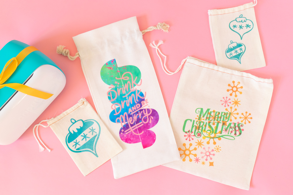 assortment of DIY holiday gift packaging ideas next to Cricut Joy machine