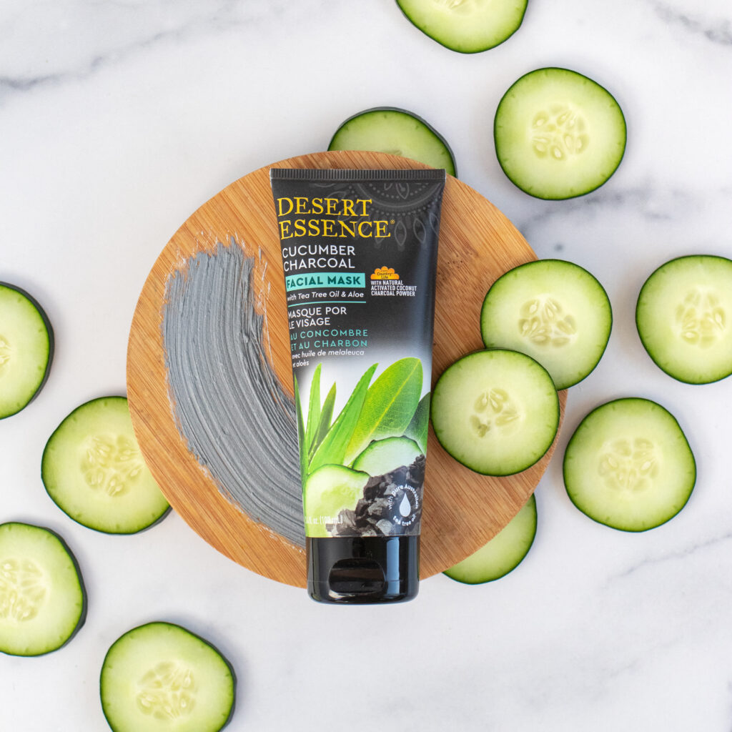 facial mask product surrounded by cucumbers