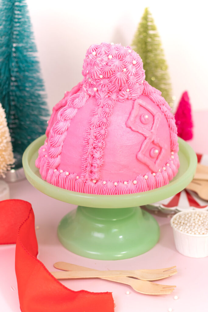 slight overhead view of pom pom cupcake on top of winter hat design