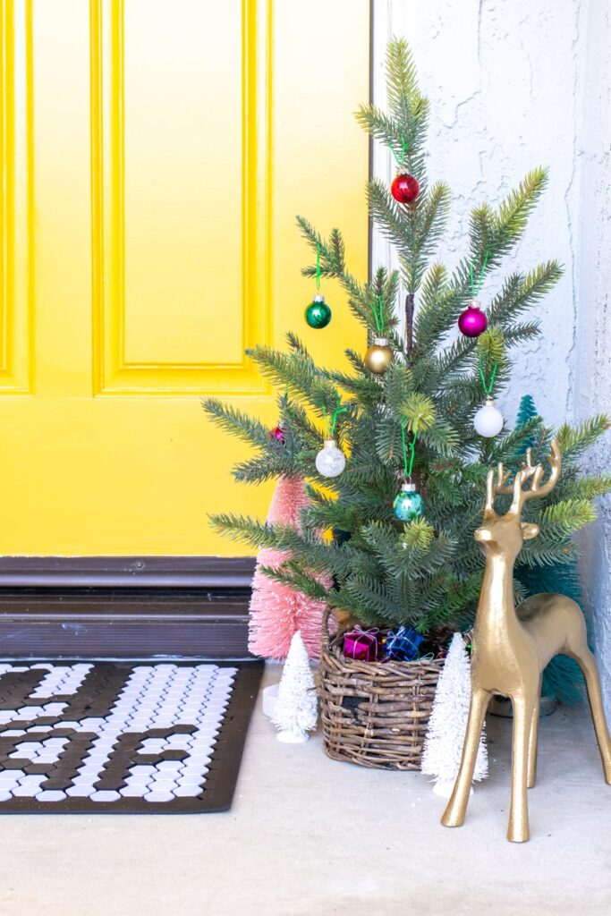 simple christmas tree in front of modernized front door