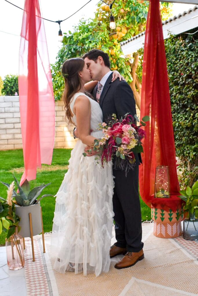 first kiss at micro backyard wedding