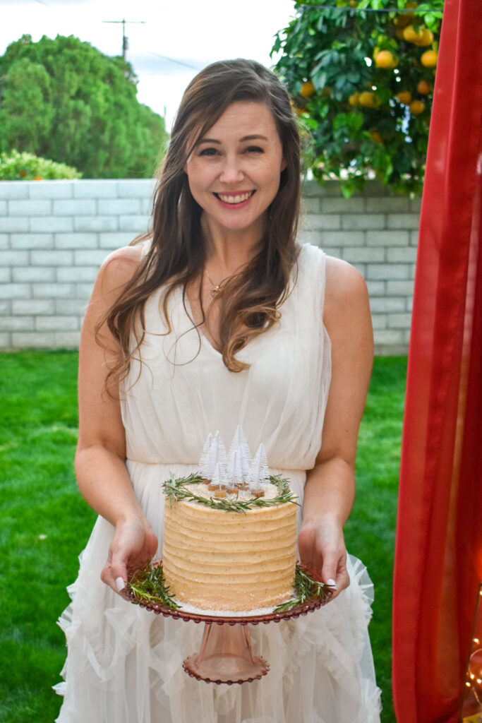 bride holding simple homemade winter wedding cake