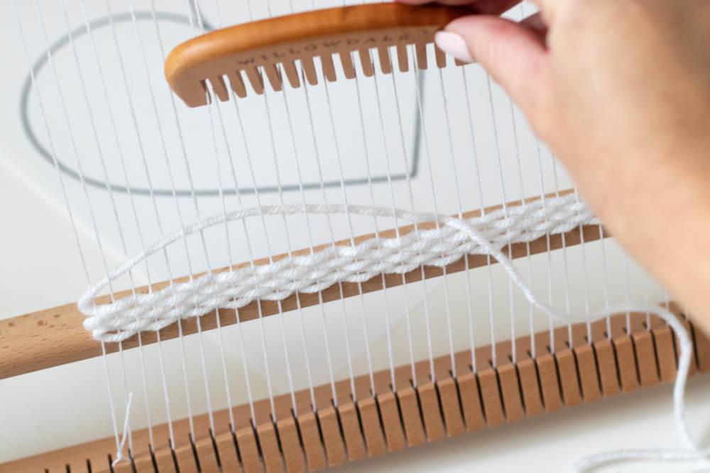 using comb to weave a wall hanging for valentines day