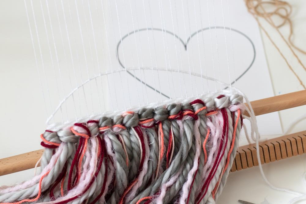 creating arc with yarn for heart weaving decor DIY