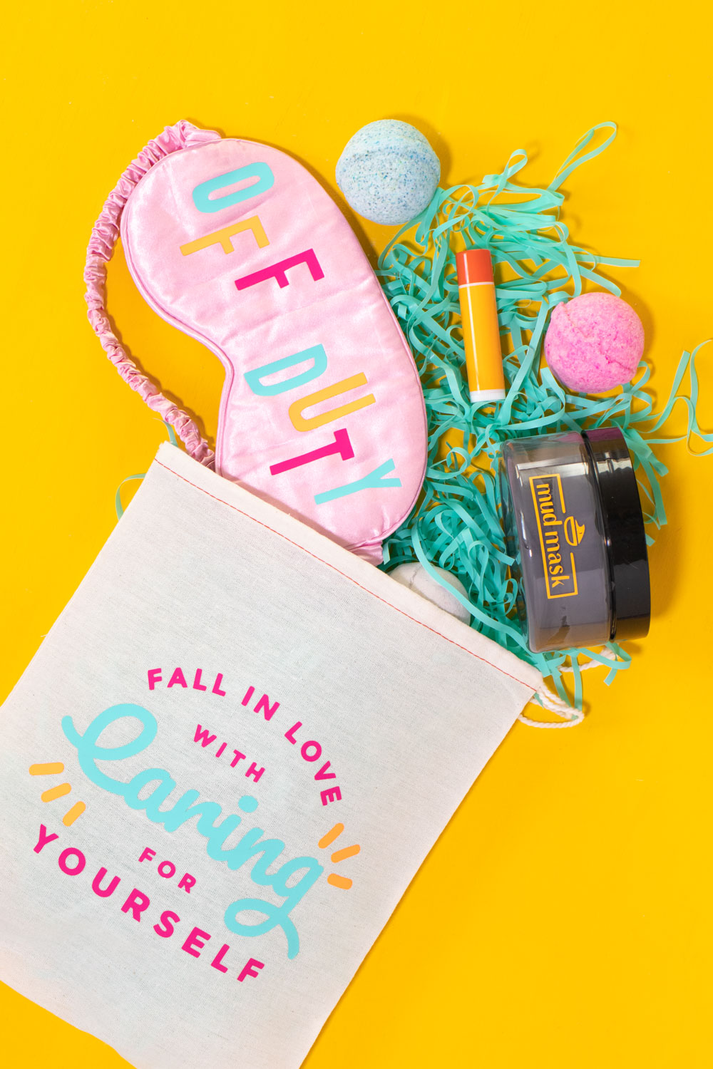 DIY self care gift basket with supplies falling out, decorated with vinyl