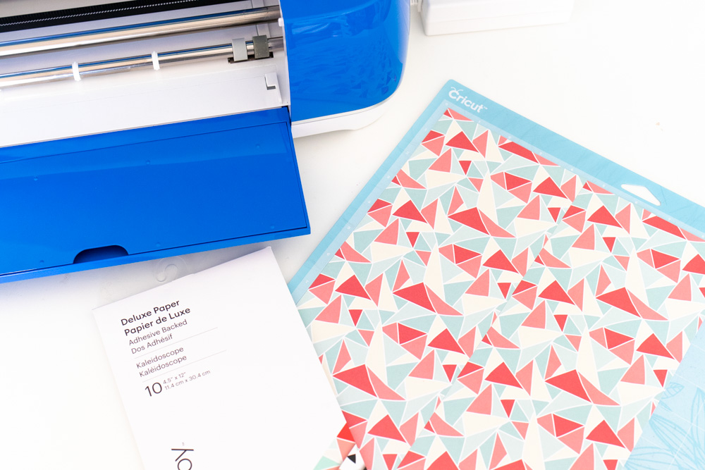 applying patterned paper to Cricut mat