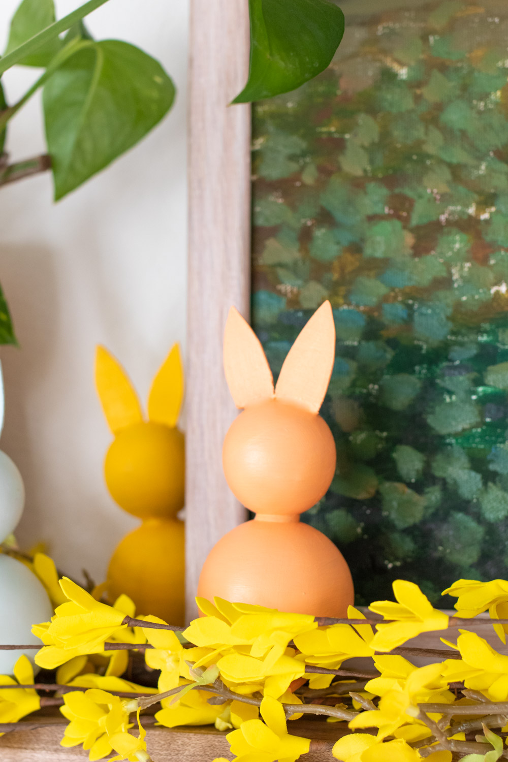 pastel colored modern easter decor on mantel