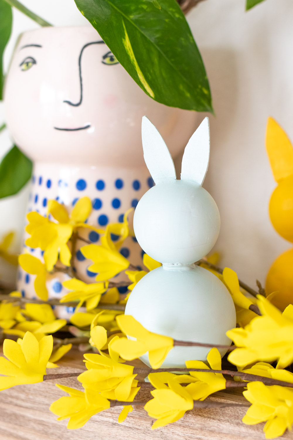 front view of modern bunny decor with plant