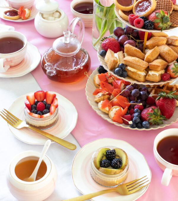 tablescape of spring tea party decor with cheesecakes and cookies