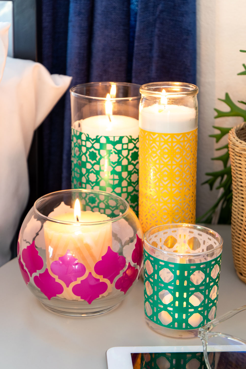 variety of colorful boho candleholders clustered in bedroom