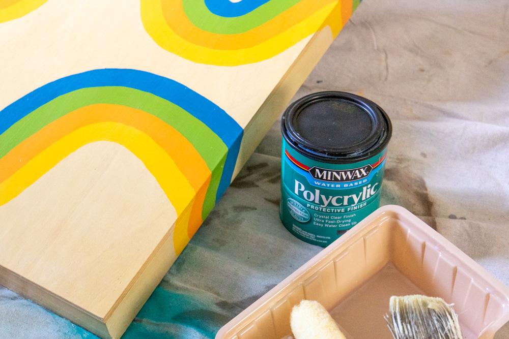 apply polycrylic to cornhole makeover project